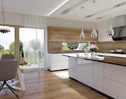 Projekt wnętrz Szczecin - Duża otwarta szara kuchnia w kształcie litery l z wyspą z oknem, styl nowoczesny - zdjęcie od DORA-design Projektowanie wnętrz Szczecin