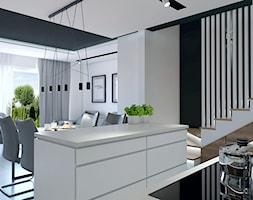 Projekt wnętrz w budynku jednorodzinnym Szczecin - Średnia otwarta biała czarna kuchnia jednorzędowa w aneksie z wyspą z oknem, styl industrialny - zdjęcie od DORA-design Projektowanie wnętrz Szczecin