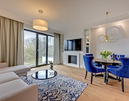 Apartament w Toruniu - Duży biały salon z jadalnią, styl nowojorski - zdjęcie od Domowe Kreatury - Homebook