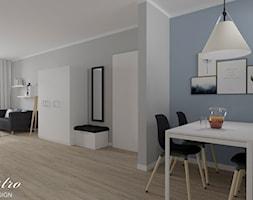Część dzienna mieszkania w stylu skandynawskim - zdjęcie od Maestro Studio Design