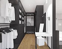 Projekt apartamentu 130m2 / garderoba Kraków - Duża otwarta garderoba przy sypialni, styl nowoczesny - zdjęcie od MARCISZ ARCHITEKCI