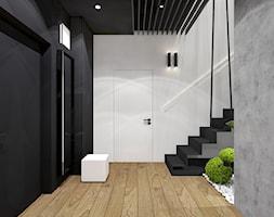 Projekt apartamentu 130m2 / hol 1 Kraków - Duży biały czarny szary hol / przedpokój, styl nowoczesny - zdjęcie od MARCISZ ARCHITEKCI