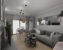 Małe mieszkanie na łódzkiej Retkinii - Średni szary biały salon z barkiem z jadalnią z tarasem / balkonem - zdjęcie od IDI Studio