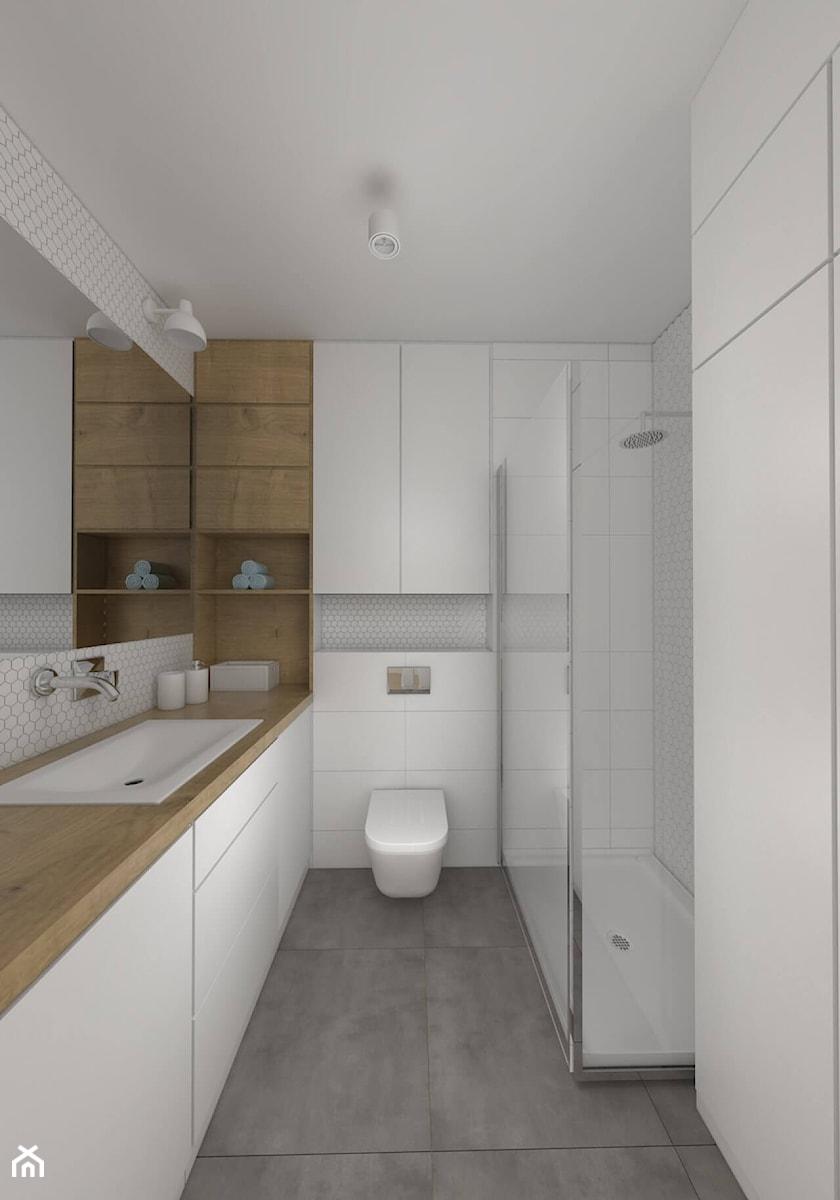 Skandynawskie klimaty w łódzkim Śródmieściu - Średnia biała szara łazienka w bloku w domu jednorodzinnym bez okna - zdjęcie od IDI Studio