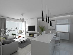 Mieszkanie na łódzkim Widzewie - Duży biały salon z kuchnią z jadalnią - zdjęcie od IDI Studio