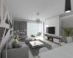 Mieszkanie na łódzkim Widzewie - Średni szary biały salon z jadalnią - zdjęcie od IDI Studio