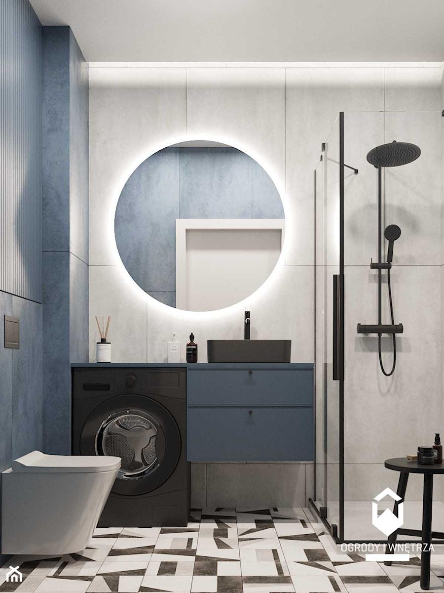 Mała łazienka z prysznicem z granatowym akcentem koloru. - zdjęcie od KAROLINA POPIEL - ARCHITEKURA WNĘTRZ