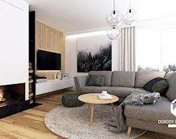 Przestrze%C5%84+wypoczynkowa+z+kominkiem+w+domu+jednorodzinnym+-+zdj%C4%99cie+od+OGRODY+I+WN%C4%98TRZA+-+KAROLINA+POPIEL