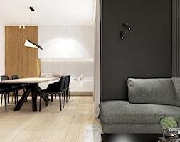 Salon z czarną ścianą i jadalnią. - zdjęcie od KAROLINA POPIEL - ARCHITEKURA WNĘTRZ - Homebook