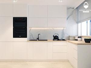 Remont mieszkania w starym budownictwie - Średnia zamknięta biała kuchnia w kształcie litery l z oknem, styl nowoczesny - zdjęcie od OGRODY I WNĘTRZA - KAROLINA POPIEL