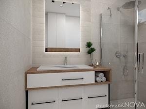 Mała łazienka z prysznicem -beż, biel oraz czarne akcenty