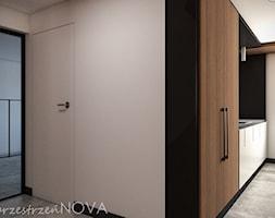 Przestrzeń biurowa firmy Repablo - Mała otwarta beżowa czarna kuchnia jednorzędowa w aneksie, styl ... - zdjęcie od przestrzeńNOVA - Homebook