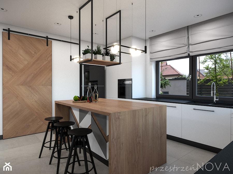W ZACISZU NATURY LOFTOWA PRESTRZEŃ - Duża zamknięta biała kuchnia w kształcie litery u z wyspą z oknem, styl industrialny - zdjęcie od przestrzeńNOVA