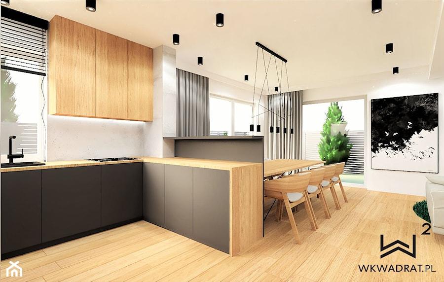 Bliźniak- część dzienna - Średnia otwarta biała kuchnia w kształcie litery l w aneksie z oknem, styl nowoczesny - zdjęcie od WKWADRAT - PRACOWNIA ARANŻACJI WNĘTRZ
