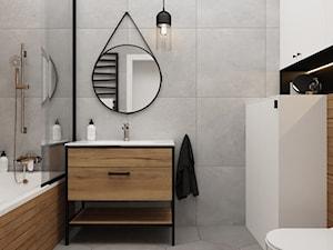 Mała łazienka w bloku z okrągłym lustrem i drewnopodobnymi kafelkami - zdjęcie od Boka Design