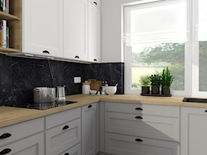 """Dom z klimatem - Średnia biała czarna kuchnia w kształcie litery l z oknem, styl skandynawski - zdjęcie od Biuro projektowe """"Patio"""" Ewa Szymczak"""