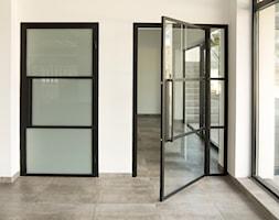 Drzwi+przeszklone+-+zdj%C4%99cie+od+OTIF+Profil+-+%C5%9Bcianki+i+drzwi+loftowe