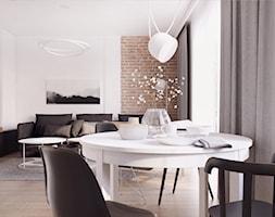 019_18 - Duża otwarta biała jadalnia w salonie, styl skandynawski - zdjęcie od NOVOO studio