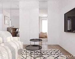 010_17 Kawalerka w Rzeszowie - Mały biały salon, styl minimalistyczny - zdjęcie od NOVOO studio