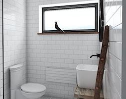 Dom o charakterze skandynawskim - Mała biała łazienka na poddaszu w bloku w domu jednorodzinnym z oknem, styl skandynawski - zdjęcie od Maria Jachalska
