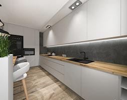 Mieszkanie w industrialnym stylu - Duża otwarta kuchnia dwurzędowa z wyspą z oknem, styl industrialny - zdjęcie od Studio Archi S