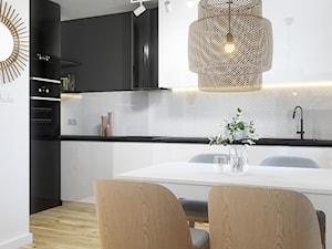 Salon z aneksem kuchennym w bloku w stylu nowoczesnym