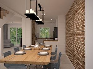 Salon w stylu industralnym -Cegła na pierwszym planie - Duża otwarta biała beżowa jadalnia jako osobne pomieszczenie, styl industrialny - zdjęcie od Ola Kulisz -projektowanie wnętrz