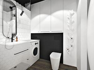 Mieszkanie dla pary. - Mała biała czarna łazienka w bloku w domu jednorodzinnym bez okna, styl nowoczesny - zdjęcie od SKOG Łucja Zielińska Projektowanie Wnętrz