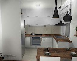 Projekt wnętrza mieszkania w poznańskim bloku - Średnia zamknięta szara kuchnia w kształcie litery l z oknem, styl rustykalny - zdjęcie od Darien Design