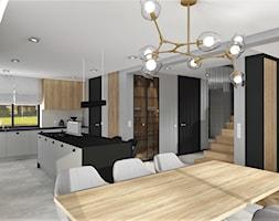 Jadalnia z widokiem na salon i kuchnię - zdjęcie od MG Design - Homebook