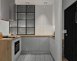 Kuchnia z witryną biała otwarta na salon - zdjęcie od MG Design - Homebook