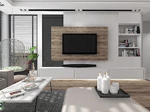 Salon z dekoracyjną ścianą TV - zdjęcie od MG Design