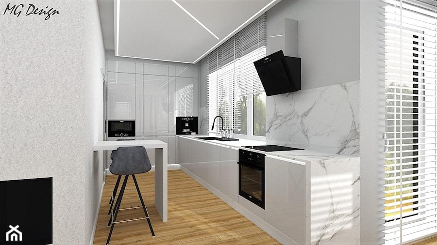Dom w Walidrogach - Duża otwarta szara kuchnia w kształcie litery l z oknem, styl nowoczesny - zdjęcie od MG Design