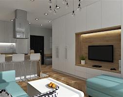 Salon ze ścianą TV - zdjęcie od MG Design - Homebook