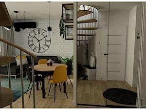 Salon z kuchnią i przedpokojem w mieszkaniu dwupoziomowym