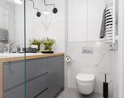 Mieszkanie+z+pomara%C5%84czowym+akcentem+-+zdj%C4%99cie+od+Loftstudio
