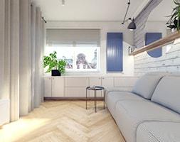 Salon+ze+%C5%9Bcian%C4%85+z+bia%C5%82ej+ceg%C5%82y+-+zdj%C4%99cie+od+NI%C3%91AS+New+Interior+Architecture+Studio