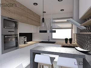 Projekt ergonomicznej kuchni - Średnia zamknięta biała czarna kuchnia w kształcie litery g z oknem - zdjęcie od LDesign Gliwice