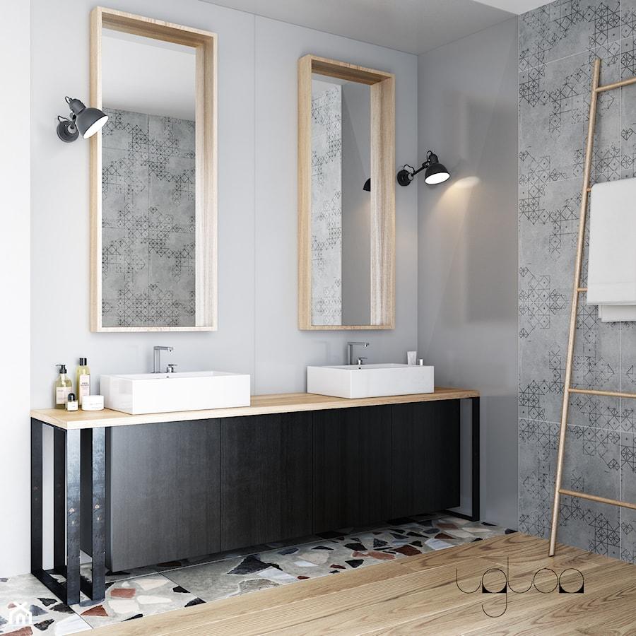 Łazienka w szarościach bieli z czarnymi dodatkami - zdjęcie od igloo studio