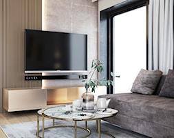 Przytulny salon z elementami złota, bieli i beżu - zdjęcie od igloo studio - Homebook