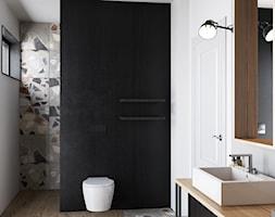 Łazienka w szarościach bieli z czarnymi dodatkami - zdjęcie od igloo studio - Homebook
