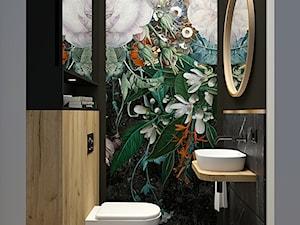 Czarna łazienka z mocnym kwiatowym akcentem