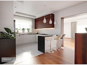 Słoneczna kuchnia. - Duża otwarta szara kuchnia w kształcie litery g z oknem, styl nowoczesny - zdjęcie od Visoo Design