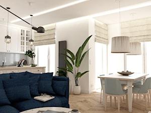 Apartament w Płońsku - Mały biały salon z jadalnią, styl klasyczny - zdjęcie od AxisDesign