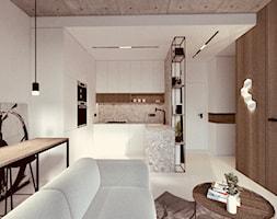Mini apartament - Mała otwarta biała szara kuchnia w kształcie litery u w aneksie, styl minimalistyczny - zdjęcie od żurawicki.design