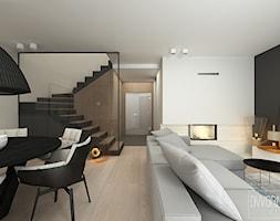 DOM Z OBRAZAMI - Średni szary biały czarny salon z jadalnią, styl nowoczesny - zdjęcie od DWORNICKA STUDIO - Homebook