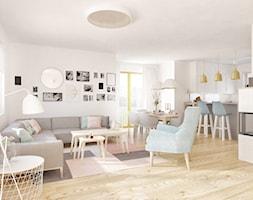 """Złoto i pastele - Duży biały salon z kuchnią z jadalnią, styl nowoczesny - zdjęcie od Pracownia Aranżacji Wnętrz """"O-kreślarnia"""""""