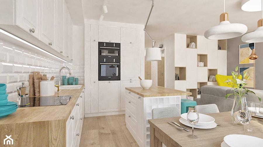 """Mieszkanie z pozytywną energią - Średnia otwarta biała kuchnia jednorzędowa w aneksie z wyspą - zdjęcie od Pracownia Aranżacji Wnętrz """"O-kreślarnia"""""""