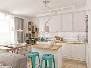 """Mieszkanie z pozytywną energią - Średnia otwarta biała kuchnia w kształcie litery l w aneksie z wyspą z oknem - zdjęcie od Pracownia Aranżacji Wnętrz """"O-kreślarnia"""""""