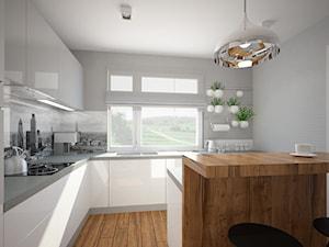 """Salon, kuchnia, przedpokój w domu jednorodzinnym - Średnia otwarta biała szara kuchnia w kształcie litery l w aneksie, styl skandynawski - zdjęcie od Pracownia Aranżacji Wnętrz """"O-kreślarnia"""""""